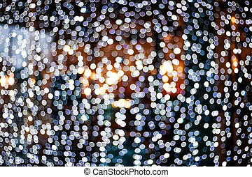Blurry garlands with bokeh. Christmas lights in the windows