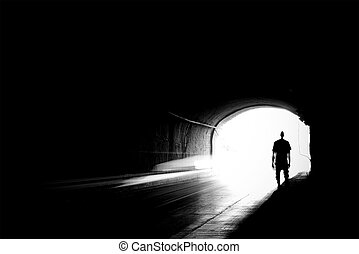Blurry image of a human silhouette in a tunnel.