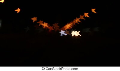 blurry light star with cars