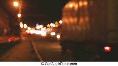 Blurry lights flow along night motorway, commuters going...