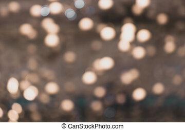 Blurry lights of urban Christmas illumination. Creammy bokeh, abstract background