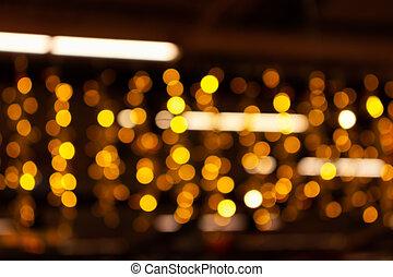 Blurry lights of urban Christmas illumination. Golden bokeh, abstract background