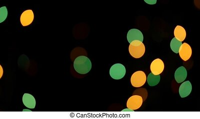 Blurry multicolored lights on black background