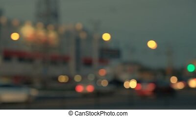 Blurry night time in the city and bokeh of moving car lights.