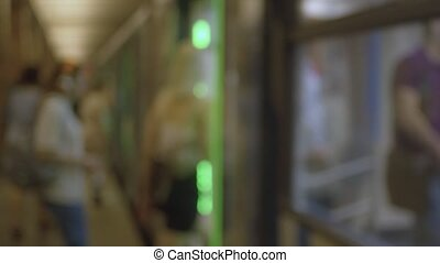 Blurry people entering the subway train - Steadicam shot....