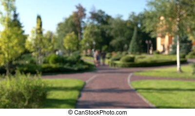 Blurry people in the park. Nature and sunshine. Best walking...
