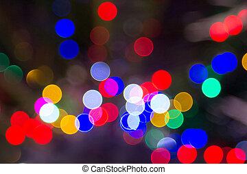 blurry red blue green yellow lights on dark background