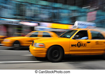 Blurry taxi new york - Blurry abstract photo of taxi cabs in...