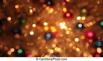 Blurry, the rotation of Christmas balls and golden tinsel....