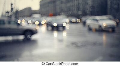 Blurry unfocused background with the city road with cars in twilight