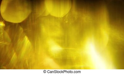 Blurry yellow background. Gold tones. Glass prism...