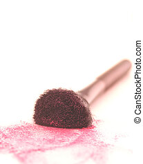 blush brush with red blush on paper