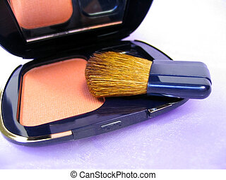 Blusher and brush over shiny lilac fabric