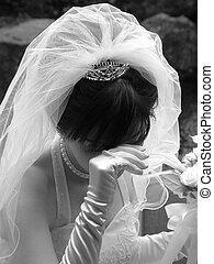 Blushing Bride - Black and white shot of a bride holding her...