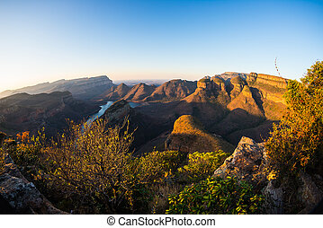 Blyde River Canyon, famous travel destination in South Africa. Last sunlight on the mountain ridges. Fisheye view from above.