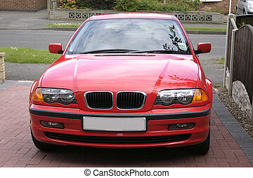 red bmw taken from a front view