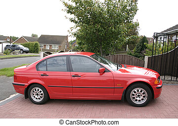 red bmw taken from a side view
