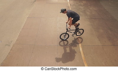 BMX bicycle rider doing trick on his bicycle - Extreme...