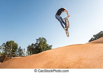 BMX Bike Stunt look back - Bmx rider performing a look back ...