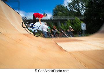 BMX Biker Performing Tricks during ride on a ramp