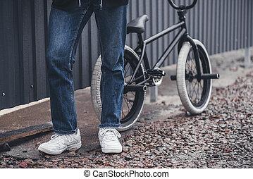 bmx biker with bicycle