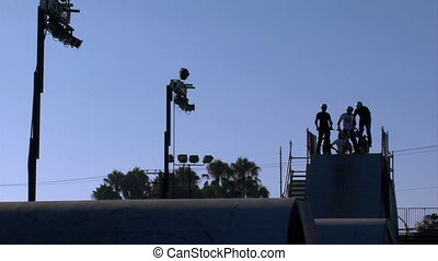 BMX Jumps Slow Motion - Slow motion silhouette shot of BMX...