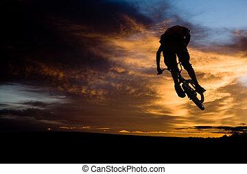 bmx rider - bike rider jum at sundown