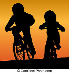 Bmx riders silhouette on sunset background.