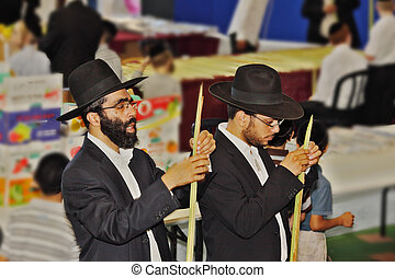 Religious Jews in black hats and piles