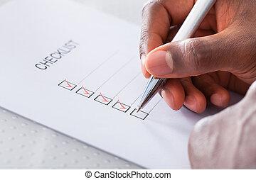 boîte, marquer, main, stylo, chèque, rouges