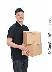 boîte, work., jeune, deliveryman, gai, appareil photo, tenue, sourire, pile