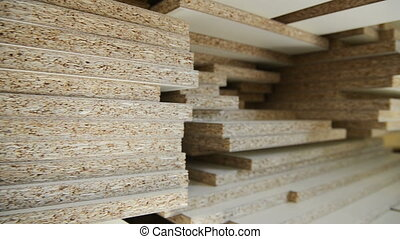 board chipboard cut parts for furniture production close-up...