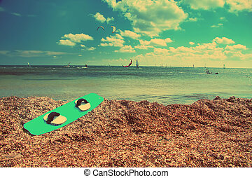 Board for windsurfing on the seashore, with a retro effect