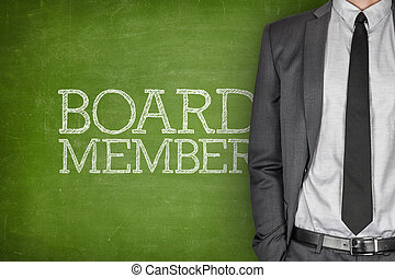 Board member on blackboard with businessman in a suit on...