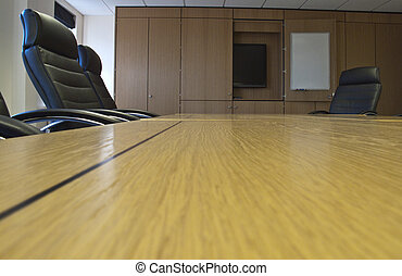 an empty board room with leather chairs