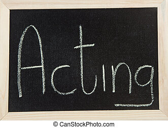 Board with ACTING - A black board with a wooden frame and...