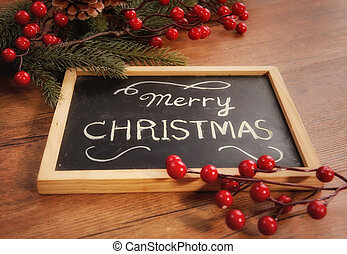 board with Christmas decoration on wooden background