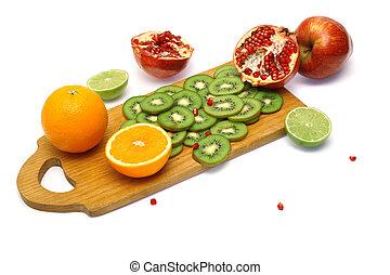 Board with cut fresh fruits