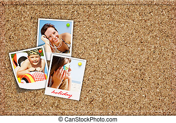 board with holiday photos of happy joying people