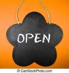 Board with the text: Open