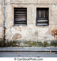 Boarded up windows in a abandoned house