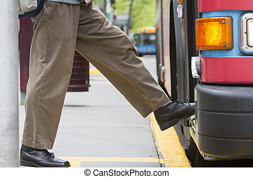 Boarding a Bus - Horizontal Photo of Person Boarding a Bus