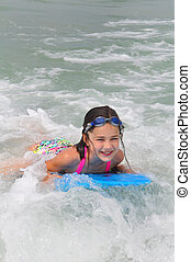 Boarding a Small Wave on Madeira Beach