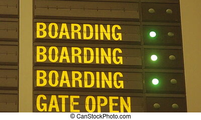 blinking boarding message on airport flight information board. Loop and seamless video.
