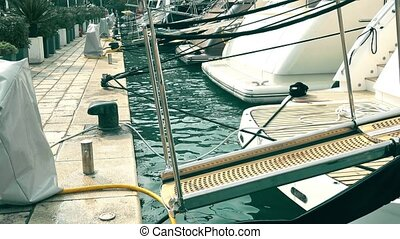 Boarding ramps of luxury yachts at marina - Boarding...