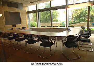 Boardroom with display screen and video conference equipment