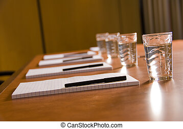 Boardroom - empty board room with water glasses and paper
