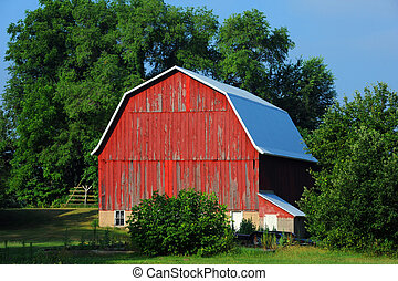 Boards on Red Barn are Cracked and Peeling