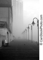 Boardwalk in Fog - Two people walking along the Halifax...