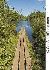 Boardwalk Leading to a Wilderness Lake